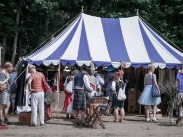 the blue and white striped tent of Zwaard en Volk at Castlefest 2018